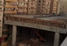 Construction d'une autoroute à quelques cm d'immeuble au Caire